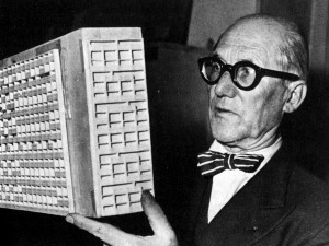 Le Corbusier looking on a scale model of on of his designs. You could definitely see the connection between it and the Brutalists.
