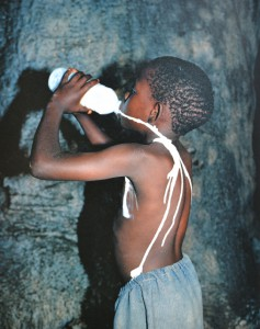 Boy drinking milk from bottle